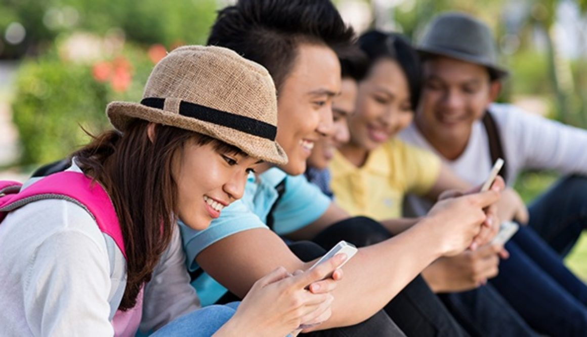 Filipino youth accessing the web using their mobile phones